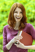 Red-haired beautiful young woman with books — Stock Photo
