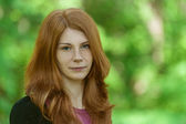 Red-haired beautiful young woman — Stock Photo