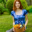 Young woman with baskets of fruit and vegetables - Foto Stock