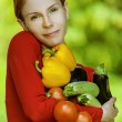 Young woman in red blouse with tomatoes, eggplants, peppers zucc - Lizenzfreies Foto