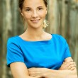 Stock Photo: Beautiful young womin blue blouse