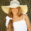 Stock Photo: Beautiful teenage in wide-brimmed hat