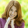 Stock Photo: Red-haired beautiful young woman