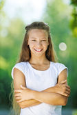 Smiling teenage girl in white blouse — Stock Photo