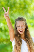 Teenage girl up two fingers in victory sign — Stock Photo