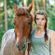 Stock Photo: Young womclose-up with horse