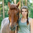 Young woman close-up with horse - Stock Photo