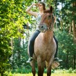 Stock Photo: Beautiful young womon horseback