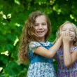 Stock Photo: Sisters playing