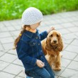 Ittle girl in denim suit with brown dog — Stock Photo #13396238