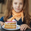 Little girl eating cake — Stock Photo #13396246