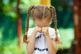 Little girl with pigtails crying — Stock Photo