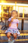Little girl eating delicious ice cream — Stock Photo
