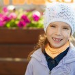 Royalty-Free Stock Photo: Funny little girl in jacket and hat