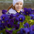 Funny little girl in jacket and hat - Stock Photo