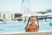 Beautiful smiling little girl at resort — Stock Photo