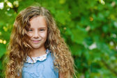 Beautiful smiling little girl close up — Stock Photo