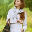Beautiful young woman with handbag — Stockfoto