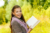Funny beautiful woman reading book — Stock Photo