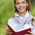 Beautiful woman reading red book — Stock Photo #13638558