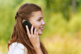 Pretty woman talking on cell phone — Stock Photo