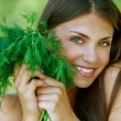 Cheerful young woman holding parsley — Stock Photo
