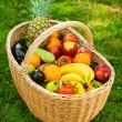 Wicker basket with fruits and vegetables - Stock Photo