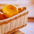 Oranges in wicker basket - Stock Photo