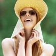 Beautiful smiling young woman in wide beach hat — Foto Stock