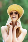 Beautiful smiling young woman in wide beach hat — Stock Photo