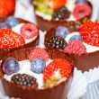 Chocolate tarts with berries - Stock Photo