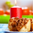 Muffins and red burning candle — Stock Photo