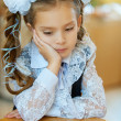 Stock Photo: Little first grader sad