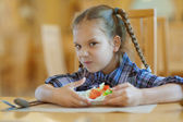 Little girl does not want to share meal — Stock Photo