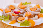 Herring, coiled with carrots and parsley — Stock Photo