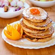 Pancakes and orange — Stock Photo