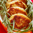 Meat cutlets with rosemary - Stock Photo
