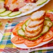 Sliced ​​meatballs with cucumbers and tomatoes — Stock Photo