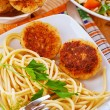 Meat patties and pasta - Stock Photo