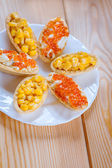 Tartlets with corn and red caviar — Stock Photo