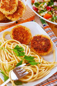Meat patties and pasta — Stock Photo