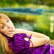 Girl lays near reservoir — Stock Photo #1597036