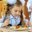 Little girl with spoon and fork — Stock Photo