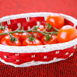 Basket with ripe tomatoes — Stock fotografie