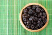Plate with dried plums — Foto de Stock