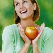 Smiling beautiful young woman with red apple — Stock Photo #16487211