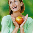 Smiling beautiful young woman with red apple — Stock Photo