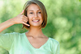 Young woman talking on phone simulates — Stock Photo