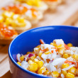Salad with corn in blue plate - Lizenzfreies Foto