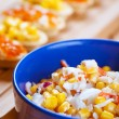 Salad with corn in blue plate - Stockfoto